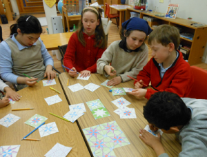 Students learn how to make geometric tiles with compass and straight edge.