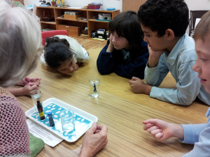 Students observe science experiment