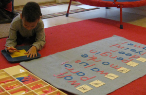Working with the moveable alphabet is a kinetic learning experience.